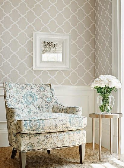 Tan and teal sitting area living room geometric modern cream and white wallpaper chair rail for Cream wallpaper for living room