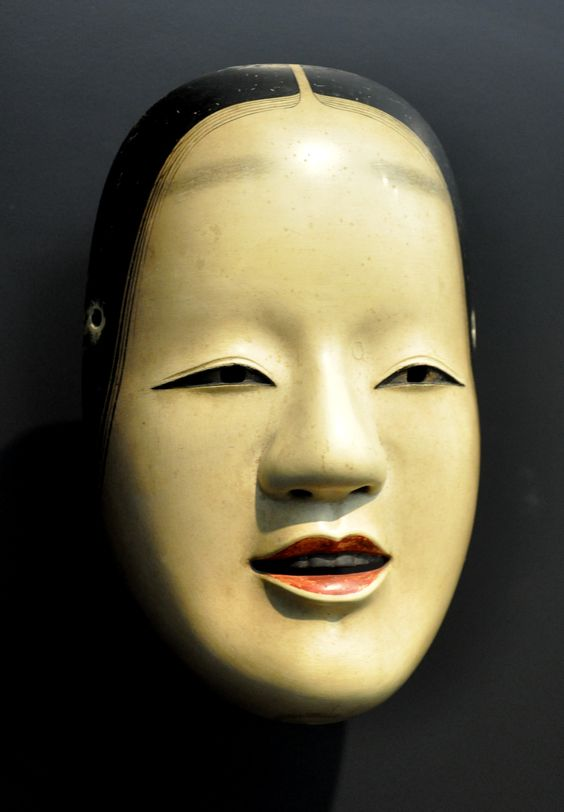 Zo-onna mask for Noh theatre -  Depicts a mature young woman with a refined, peaceful, otherworldly expression. Often used for divine or otherwise supernatural female characters.
