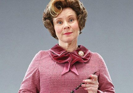 Dolores Umbridge, worked for the ministry and Voldemort, was a strict, abiding teacher who planned to make Hogwarts a school without any wand use, was in charge of keeping the locket/horcruxe, gave Harry the scar with the words I must not tell lies engraved on his hand, never gave anyone a chance to do things their way, liked power