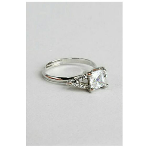 PRINCESS CUT RING Gorgeous princess cut rhinestone ring! A beautiful setting that will make your hand shine! Jewelry Rings