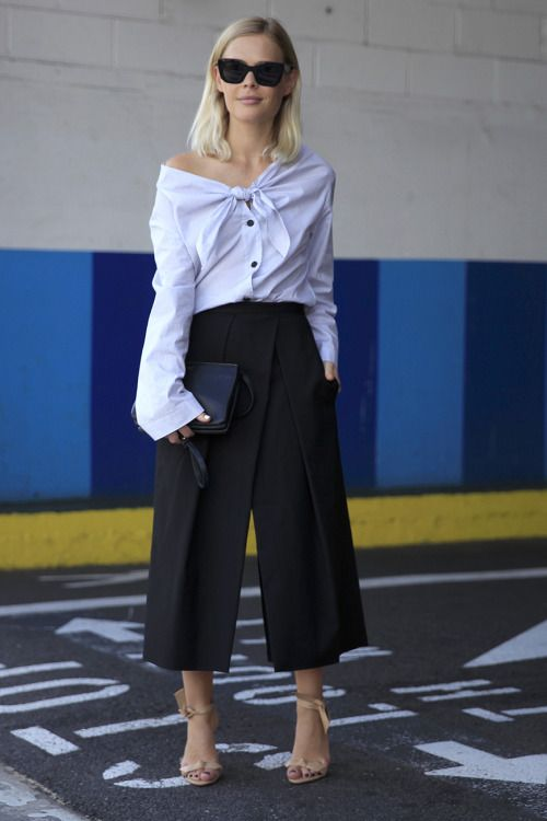 Off the shoulder styles seen at #NYFW Streets. WGSN Street Style Shot.