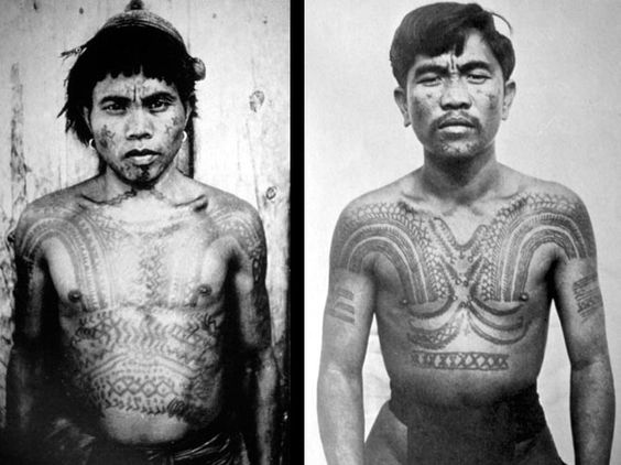 Two Bontoc Igorot men with chaklag (chest tattoo), ca. 1900-1920. Facial markings indicate their status as warriors of the highest rank. Bontoc warriors oftentimes tattooed over scars received on the field of battle.