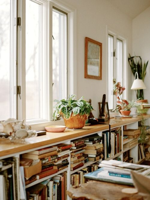 Book shelf under the window: