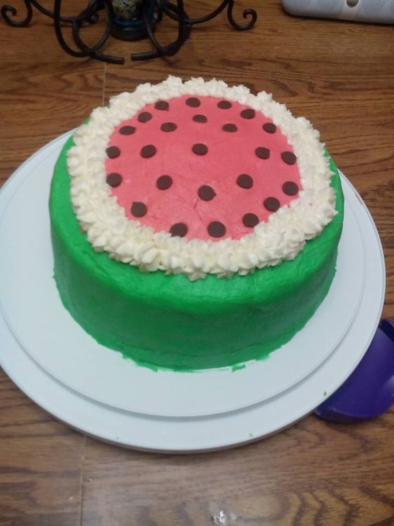 July 2015  Watermelon flavored cake (Complete w/ edible seeds).    Buttercream icing decorated to look a little like a watermelon. As much as I could. I tried lol.
