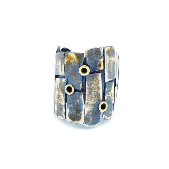 Sterling siver oxidized and aged layered wide band ring, set with Steel eyelets