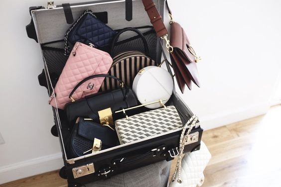 A briefcase/carryon full of purses. Love!!! (Blogger Style Diaries: New York Fashion Week Edition)