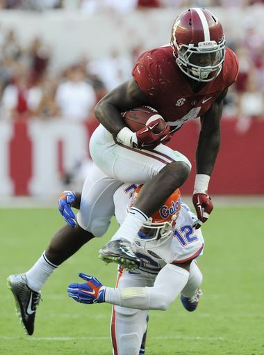Alabama running back T.J. Yeldon (4) shakes the tackle of Florida defender Quincy Wilson (12) at Bryant Denny Stadium in Tuscaloosa, Ala. on Saturday September 20,  2014.
