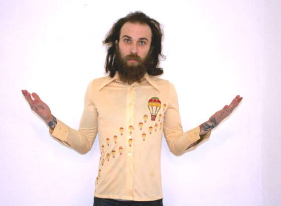 A beige color vintage shirt is adorned with tons of amazing retro styled hot air balloons