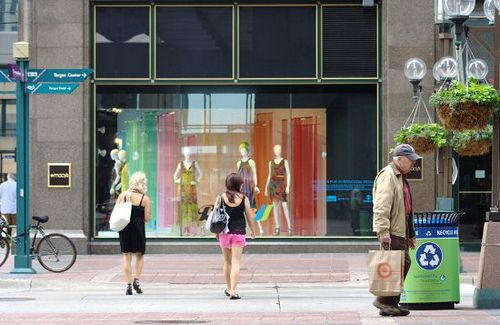 Nicollet Mall walkers, out for a stroll - and some shopping from the looks of it - on a nice summery day in downtown Minneapolis
