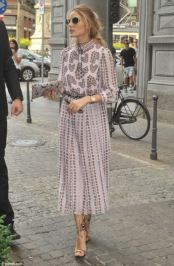 Pretty in pink! Olivia Palermo, 30, looked gorgeous in a pink floral shirt dress as she he...