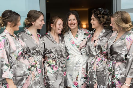 A bride and her maids in matching robes during bridal prep.