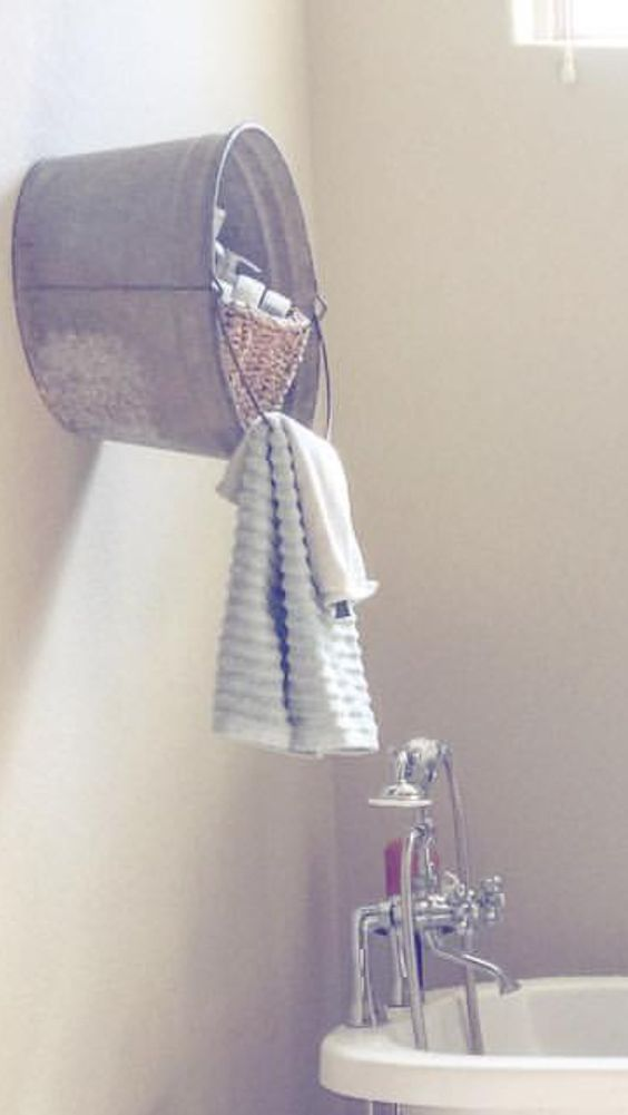 Galvanized tub attached to wall as a shelf. Love this! #farmhouse #bathroom