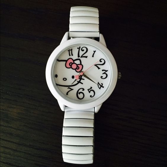 Hello Kitty Watch Never used! Brand new in original box. Super clean. No scratches. Battery no longer works but with a pop-off back (still covered with plastic) it's easy to replace! So adorable and flirty! A Hello Kitty lovers collectable dream watch! Jewelry