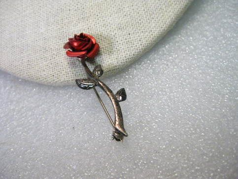 """Vintage+Sterling+Silver+Satiny+Red+Long+Stem+Rose.++It+is+about+1.75""""+long+and+1/2""""+wide.++It+is+signed+on+the+back+but+I+cannot+read+it+-+it+looks+like+a+script+J+and+some+thing+else.++It+has+been+tested+and+is+sterling+as+well+as+being+marked+925.++It+is+2.96+grams+in+weight.++It+does+have+ligh..."""