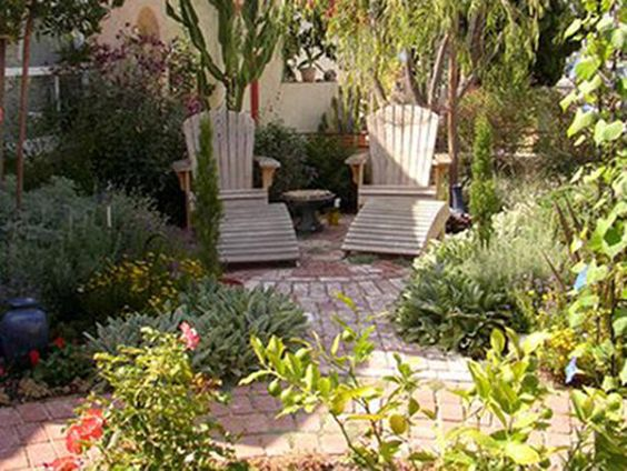 Drought tolerant plantings surrounding a small brick patio for Front yard patio courtyard
