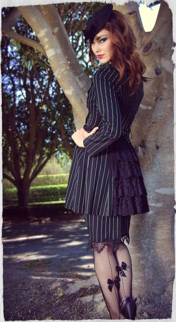 Envy Pinstripe Trench Coat made by Kitten d'Amour. Also: gorgeous stockings! Seams and bows