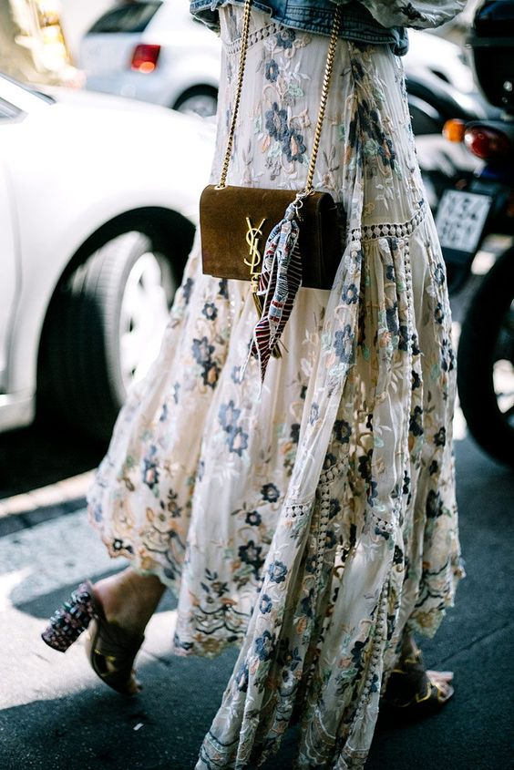 Floral skirt, mules, and the perfect scarf to top off the handbag