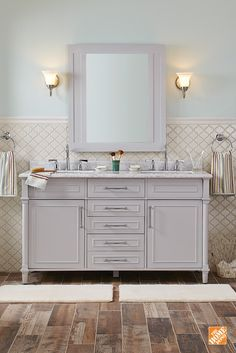 Create a contemporary and elegant bathroom with this Aberdeen Double Vanity. It features neutral grey drawers that contrast with a beautiful white European Carrara marble top. This vanity is perfect for any master or Jack and Jill bathroom. Its four drawers and two shelves hidden behind doors provide plenty of space to store toiletries and more.