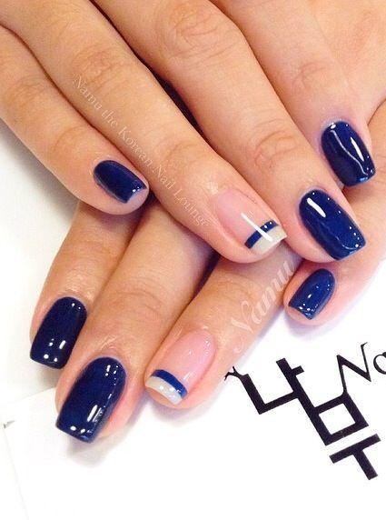 Blue mani with accent nail that is french tipped lined with blue:
