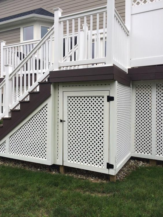Privacy lattice with a customized door creates useable storage space under a deck. #housetrends http://www.hmlandscaping.com