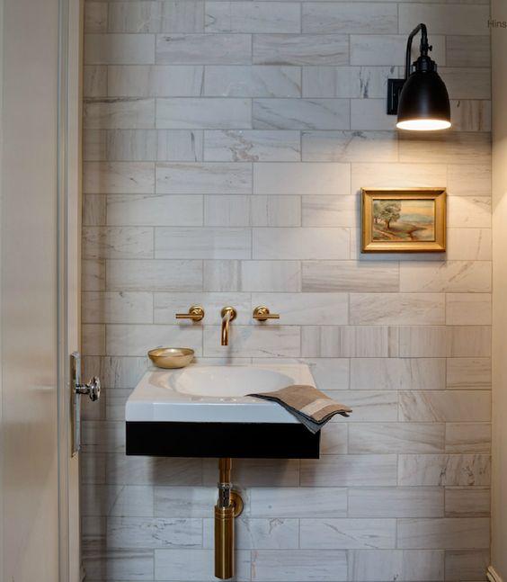 beautiful powder room with marble subway tile backsplash