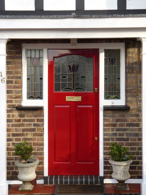 A 1920s style red door with stained glass inserts and for 1920s window styles