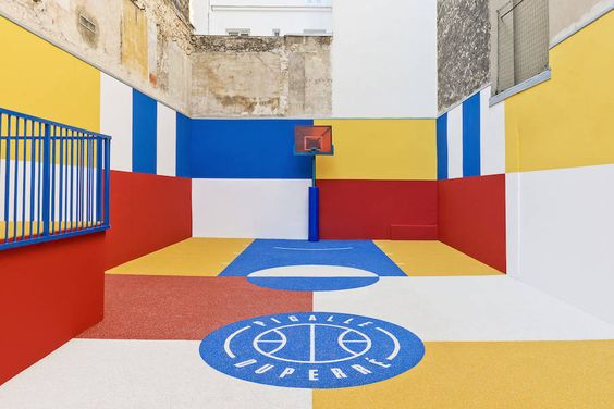A New Colorful Basketball Court In Paris Pigalle Basketball Piet Mondrian Painting Basketball Court