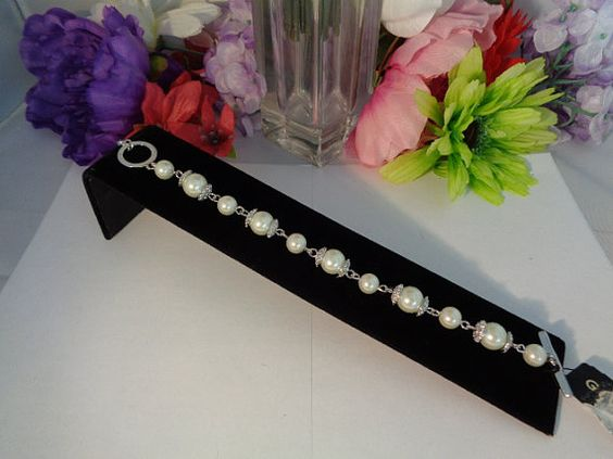 30% off coupon !  Vintage Givenchy Faux Pearls, Silvertone, Rhinestones Bracelet. The Givenchy Bracelet Price was dropped today as we sold the Matching Necklace. Take advantage of our Christmas in July Sale. Just use the coupon code to  772016 and watch the bracelet signed by Givenchy have the price reduced. www.CCCsVintageJewelry.com.