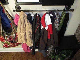 towel bar + shower curtain hooks = coat rack (hang low so kids can reach)