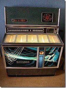 Máquina de discos en el bar,(con monedas)