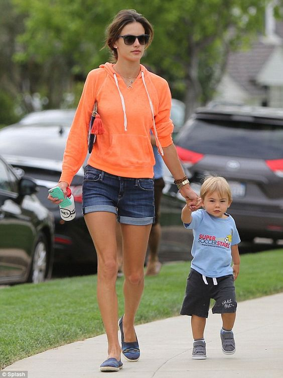 Playtime! Ambrosio gently held her son Noah Mazur's hand while preparing to embark on a play date in Palisades on Friday