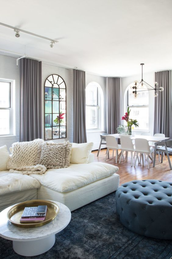 The overdyed Turkish carpet and the velvet pouf are the perfect contrast to the…