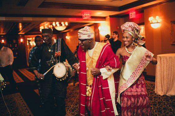 African wedding - bride and groom making wedding reception entrance - gele - aso ebi