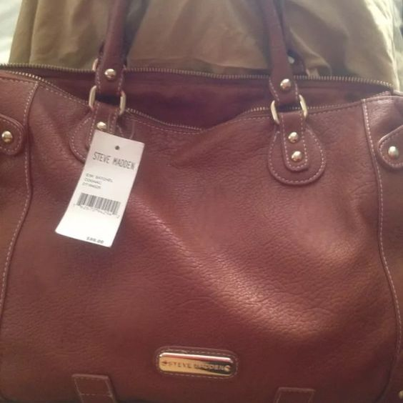 Steve Madden hand/shoulder bag Brand new w/ tags. Camel color w/ faux cream color fur detail. Spacious with out side pocket and interior. All reasonable offers considered and accepted Steve Madden Bags Shoulder Bags