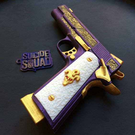 Jared Leto's Joker Gun from Suicide Squad (3D Printed) ($219) ❤ liked on Polyvore featuring home, home decor, purple home decor, outdoor home decor, outside home decor and purple home accessories