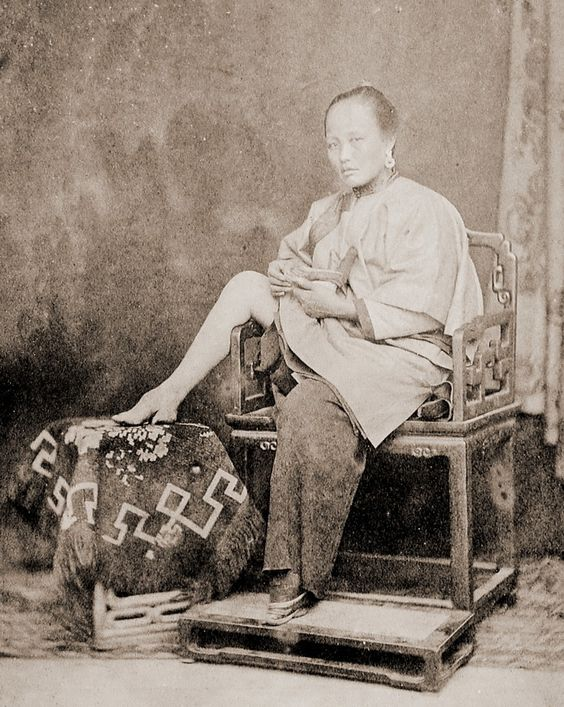 China - 1865. - Chinese womwn showing her little foot