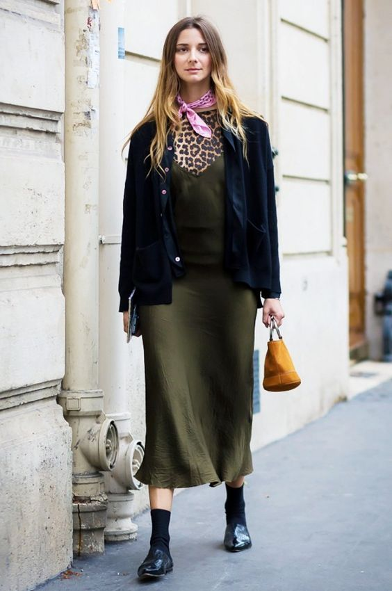 Layer a slip dress over a printed top and pair with a cardigan, pink scarf, loafers, and a mini bucket bag for an on-trend look