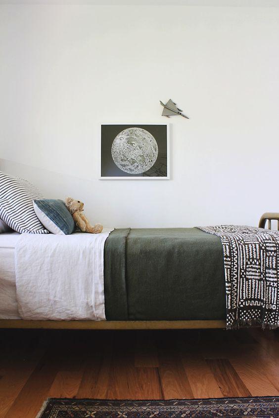 Minimalist boys room with moon print.