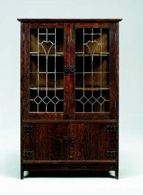 "Stickley's Leaded Glass China Cabinet -- According to Pinner, ""This beautiful and dramatic Gustav Stickley china cabinet was designed by LaMont Warner, perhaps one of the greatest American Arts & Crafts Designers."""