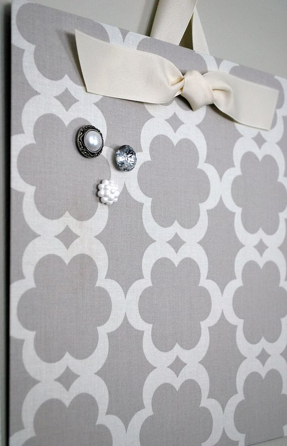 Cover a flat cookie sheet with fabric and you have a cute magnetic board---will get cookie sheet from dollar tree!