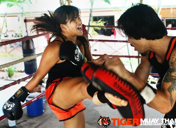 Even our guest relations manager, Joey gets in on the Muay Thai training. Ladies are more than welcome here! :D www.tigermuaythai.com