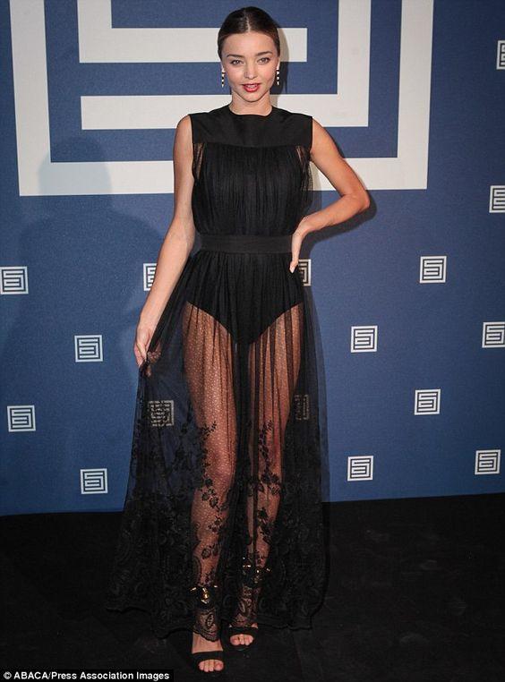 Miranda Kerr wore a a black leotard under a sheer overlay at theShiatzy Chen's runway show...so stunning