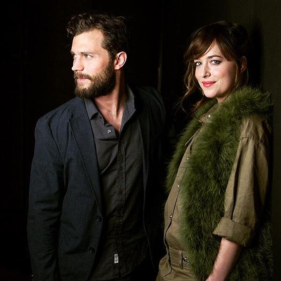 Another great outtake of Jamie Dornan and Dakota Johnson. He is starring off into the distance and she is looking right at you!! 50 Shades of Christian and Ana