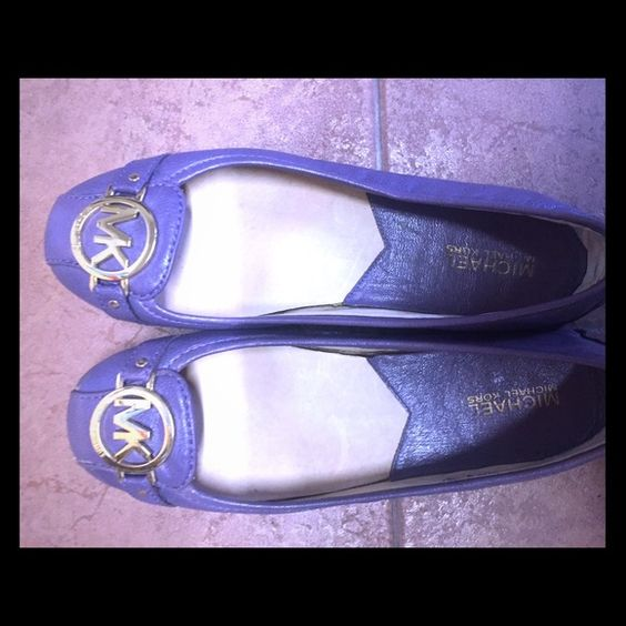 Michael Kors flats A fun lavender/purple color MK flats are sure to turn heads! Only worn a few times. Leather shows no wear. In great condition. Size 8! Michael Kors Shoes Flats & Loafers