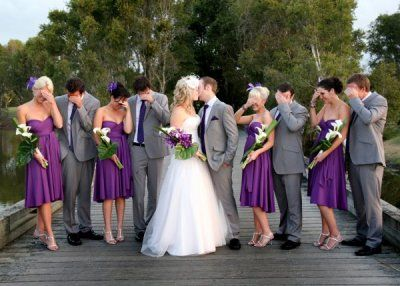 Purple bridesmaid and grey tuxes: