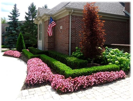 Front yard landscape design with boxwood hedges and for Flower landscaping ideas for front yards