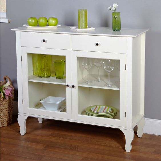 THIS ITEM WILL ARRIVE IN 8-15 DAYS AND ONLY SHIPS TO THE CONTINUOUS UNITED STATES. Complete the look of your living space with this Antique White Sideboard Buffet Console Table with Glass Doors. The b