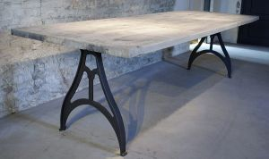 Industrial design table with cast iron legs as a base and a tabletop of reclaimed oak carriage planks. Please take a look at our website for more tables, pictures and info