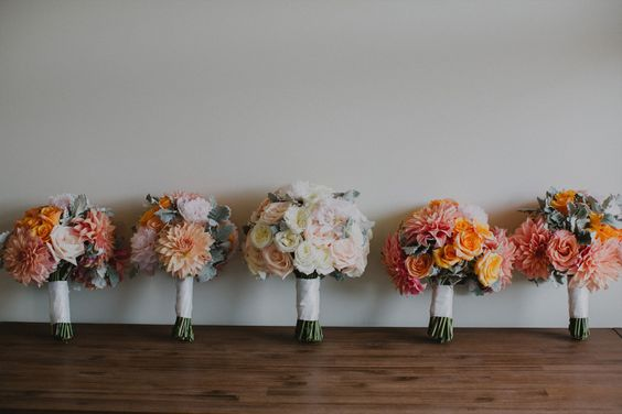 A Blooming Brilliant Wedding - Bridal Bouquet, Bridesmaid's Bouquet, Buttonhole, Boutonniere, for Luke and Emily. Including Roses Dusty Miller Peonies Orange Peach