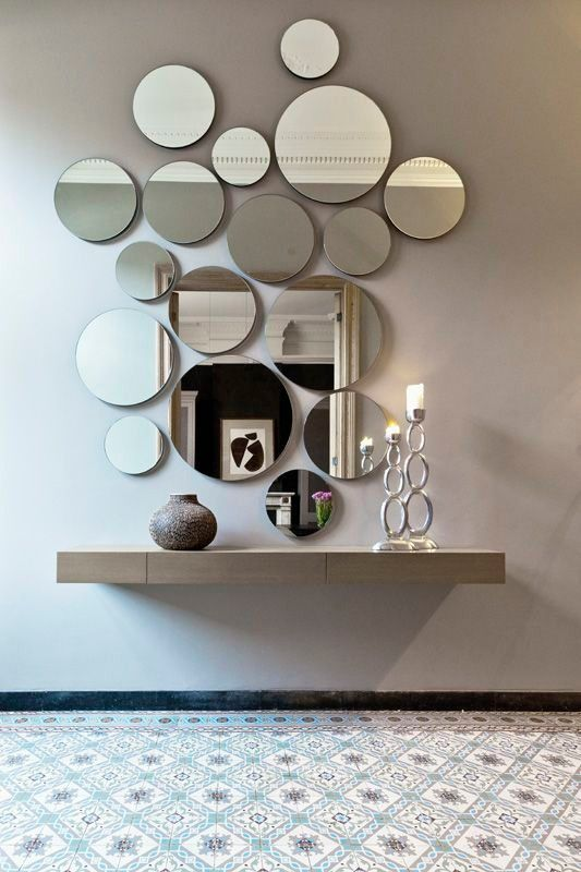 Multiple Round Mirrors In Various Sizes On The Wall With Floating Shelf Will Be A Beautiful Decoration For The Main Entrance In 2020 Mirror Design Wall Mirror Decor Mirror Wall Decor